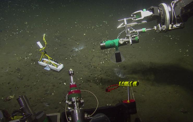 A hydrophone is placed on the ocean floor to record the sound of bubbles.