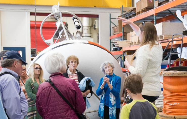 Tour group learning more about moored buoys at the 2017 Open House.
