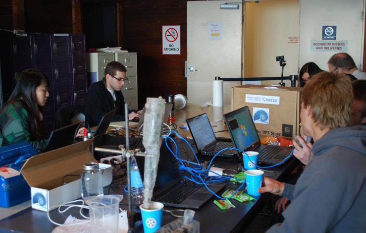 Photo of teams examining sensors after Phase 3 trials