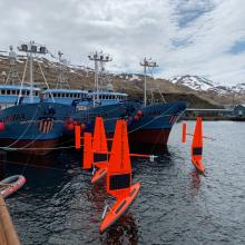 Three of six saildrones getting ready for deployment from Dutch Harbor, AK, on the 2019 Arctic mission